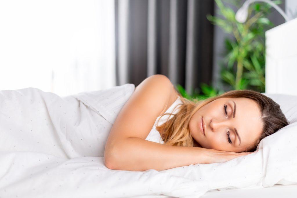 women sleeping from wearing moonstone bracelet